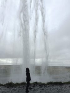Standing underneath Seljalandsfoss in Iceland