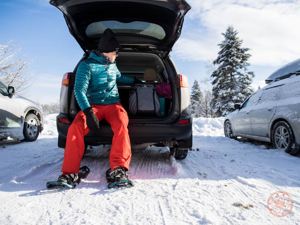Putting on the snowshoes by the car at Mew Campground in Algonquin