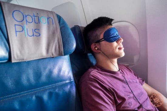 Comforts of earphones, pillow, and eye shades on Air Transat flight