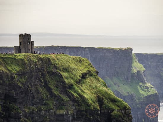 The huge crowds of tourists by the tower at Cliffs of Moher