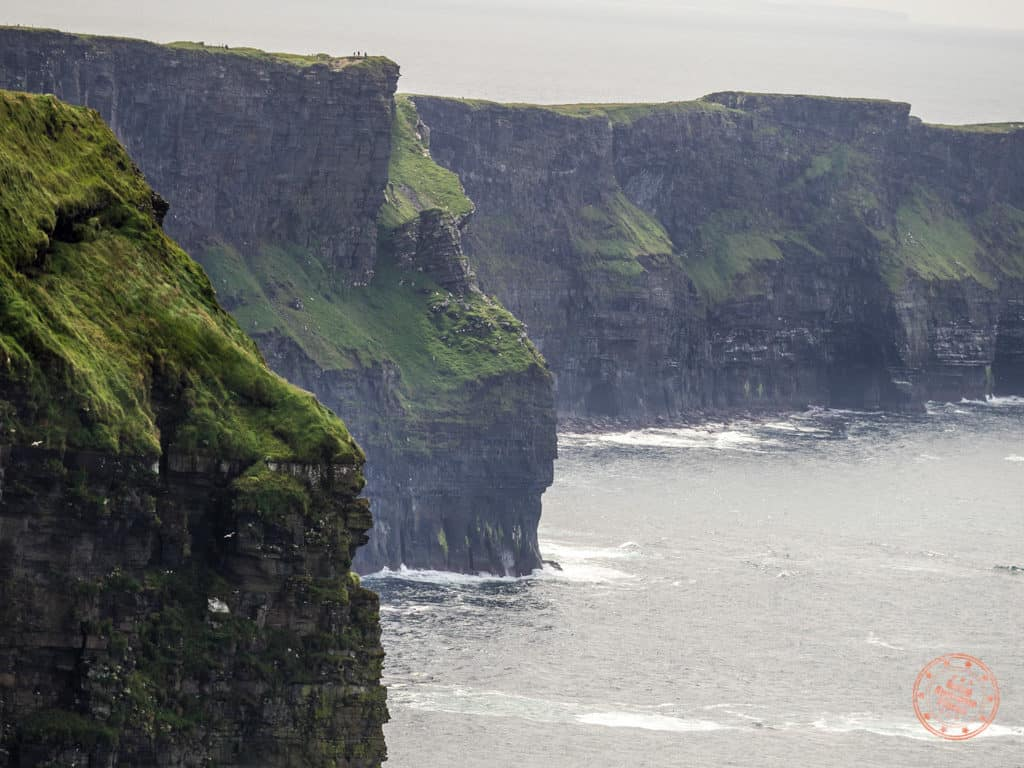 Green and jagged Cliffs of Moher in Ireland