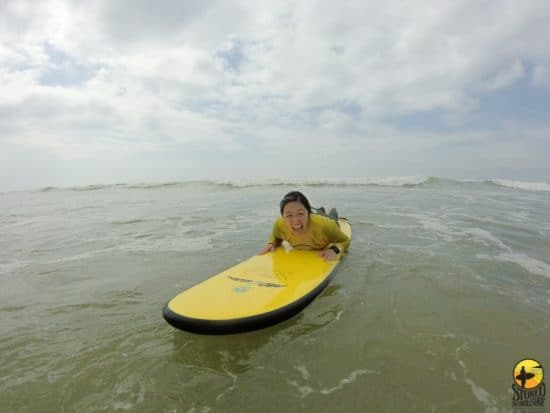 Getting on the surf board at Muizenberg