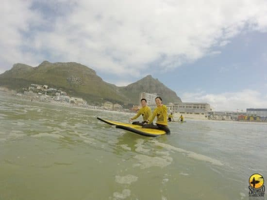 Couple Surfing With Stoked