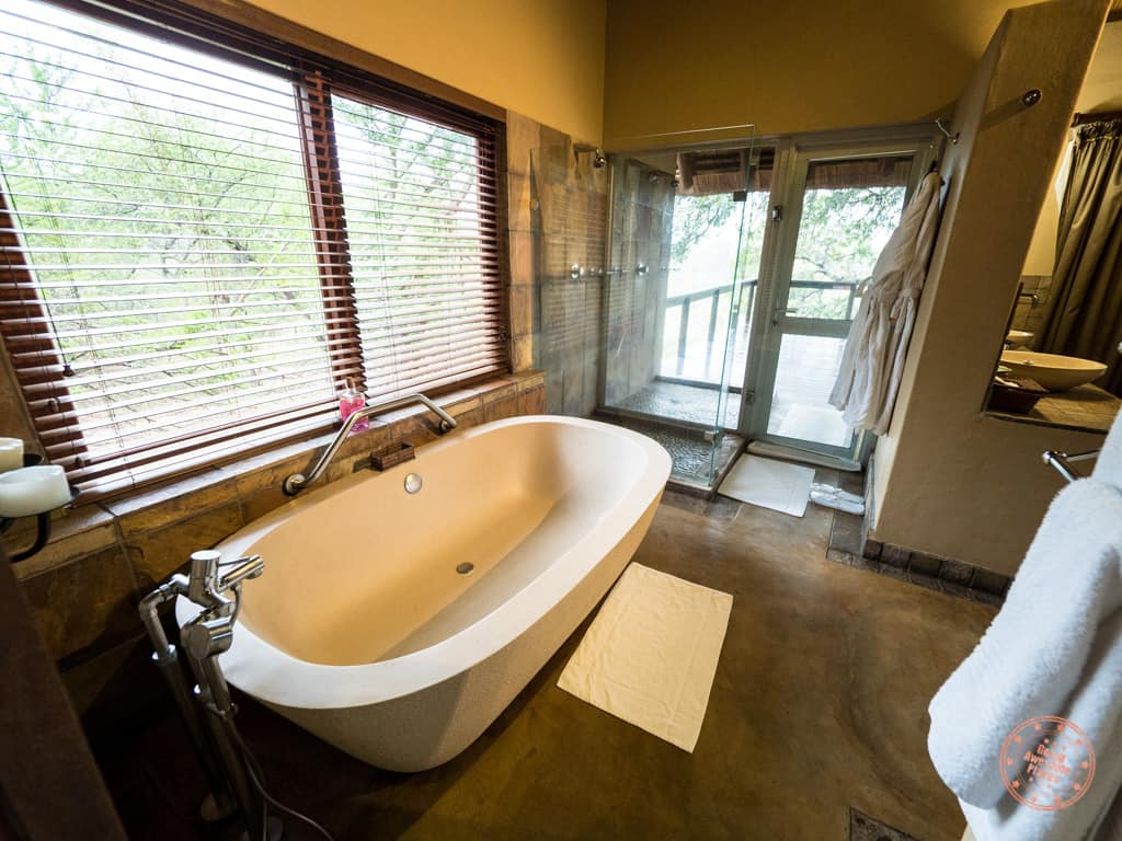 bathtub and glass shower in honeymoon suite of Elephant Plains