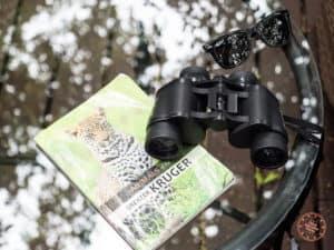 binoculars and kruger animal guide book at elephant plains
