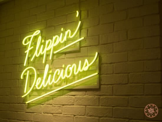 flippin' delicious neon sign