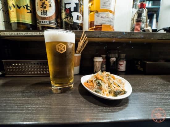 beer and appetizer at bar in omoide yokocho