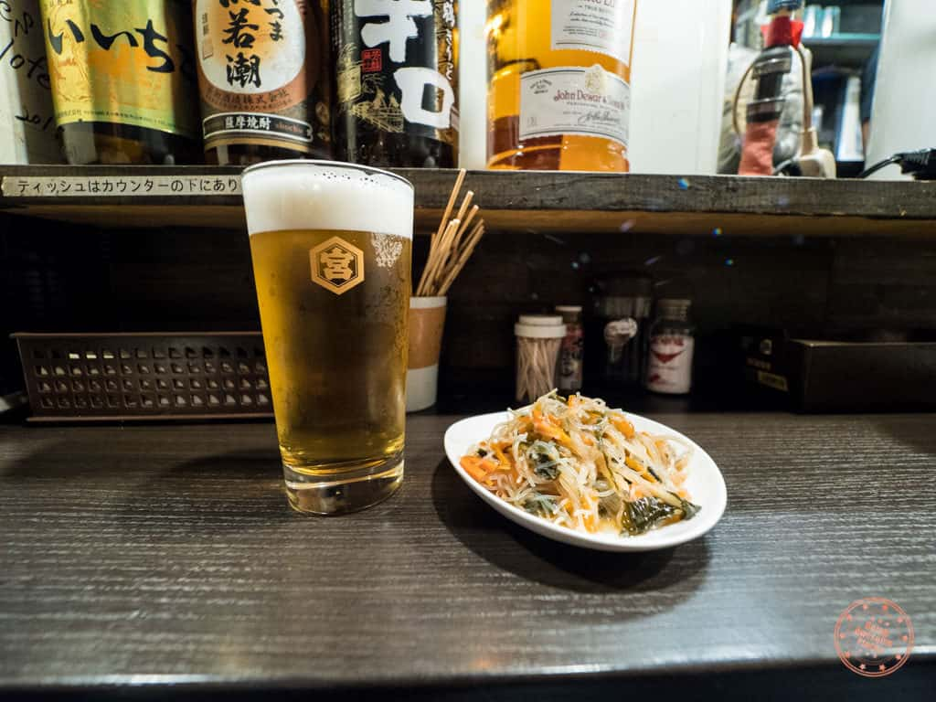 beer and appetizer at bar in omoide yokocho