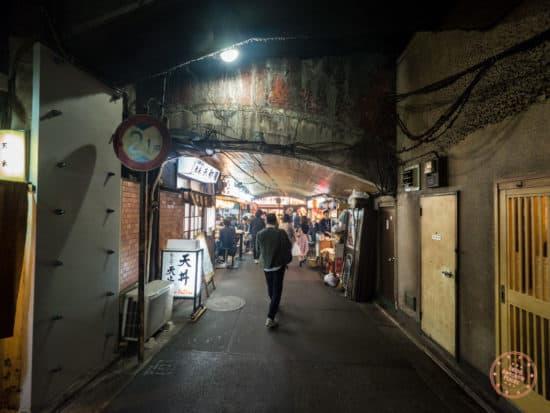 throughway under the bridge where you'll find yakitori ton ton