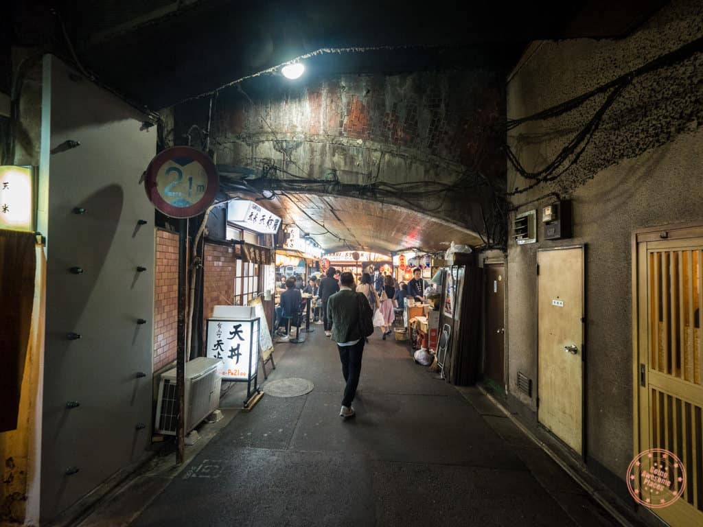 throughway under the bridge where you'll find yakitori ton ton