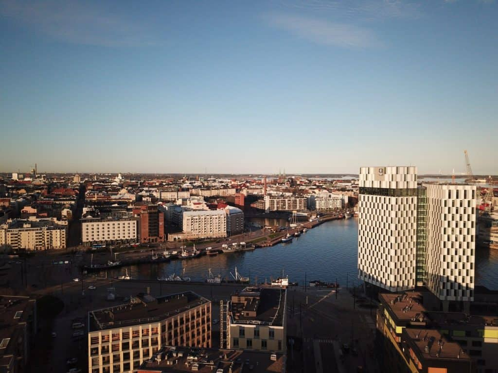 drone shot of clarion helsinki hotel at sunset