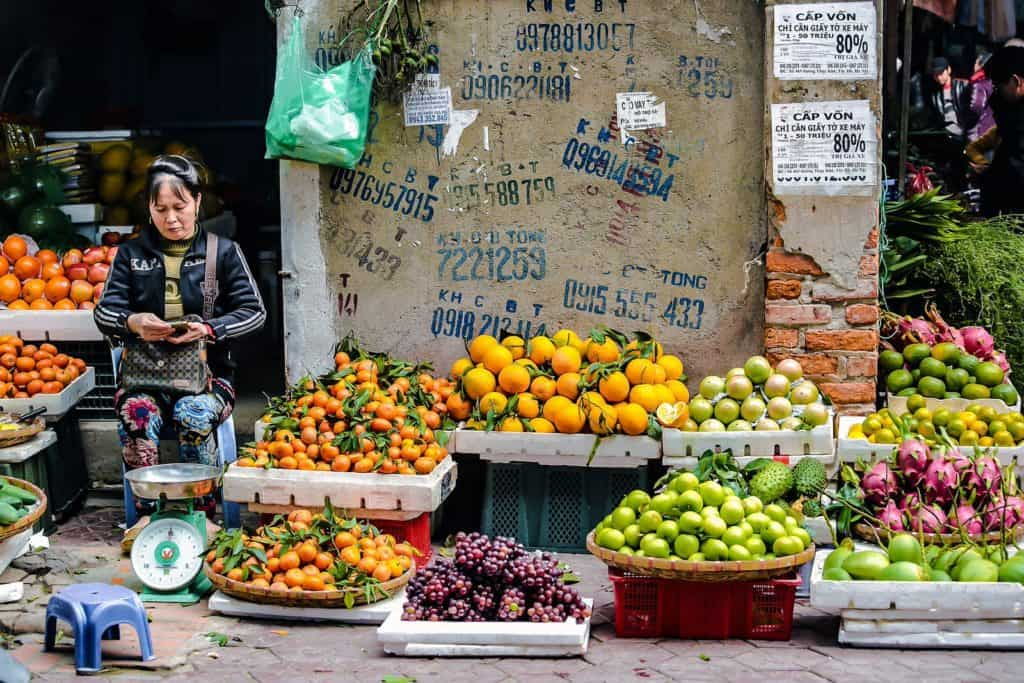 hanoi local street market with fruits