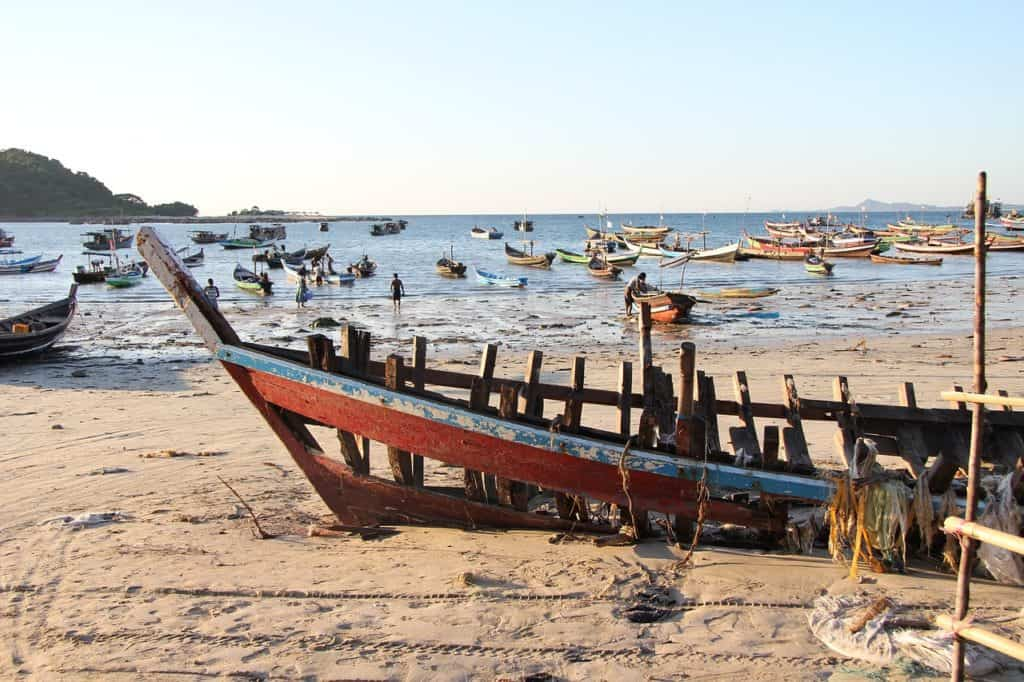 myanmar beach with a traditional boat