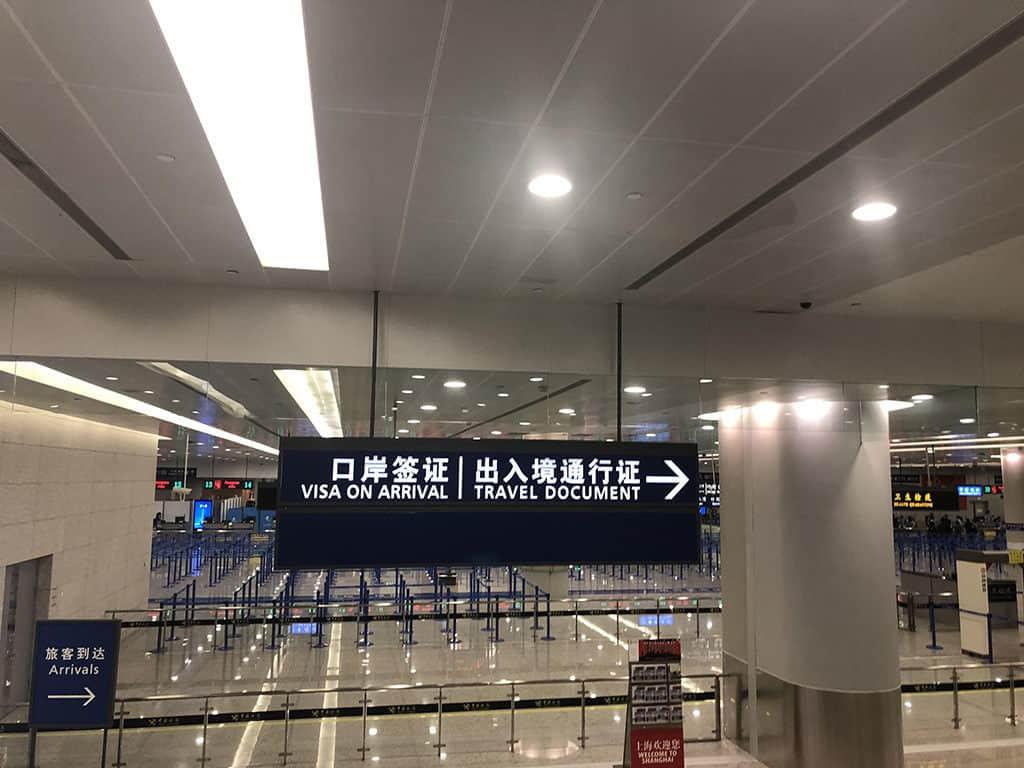 pvg shanghai airport sign for in-transit visa
