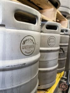 whitewater rafting company kegs seen at brewery tour