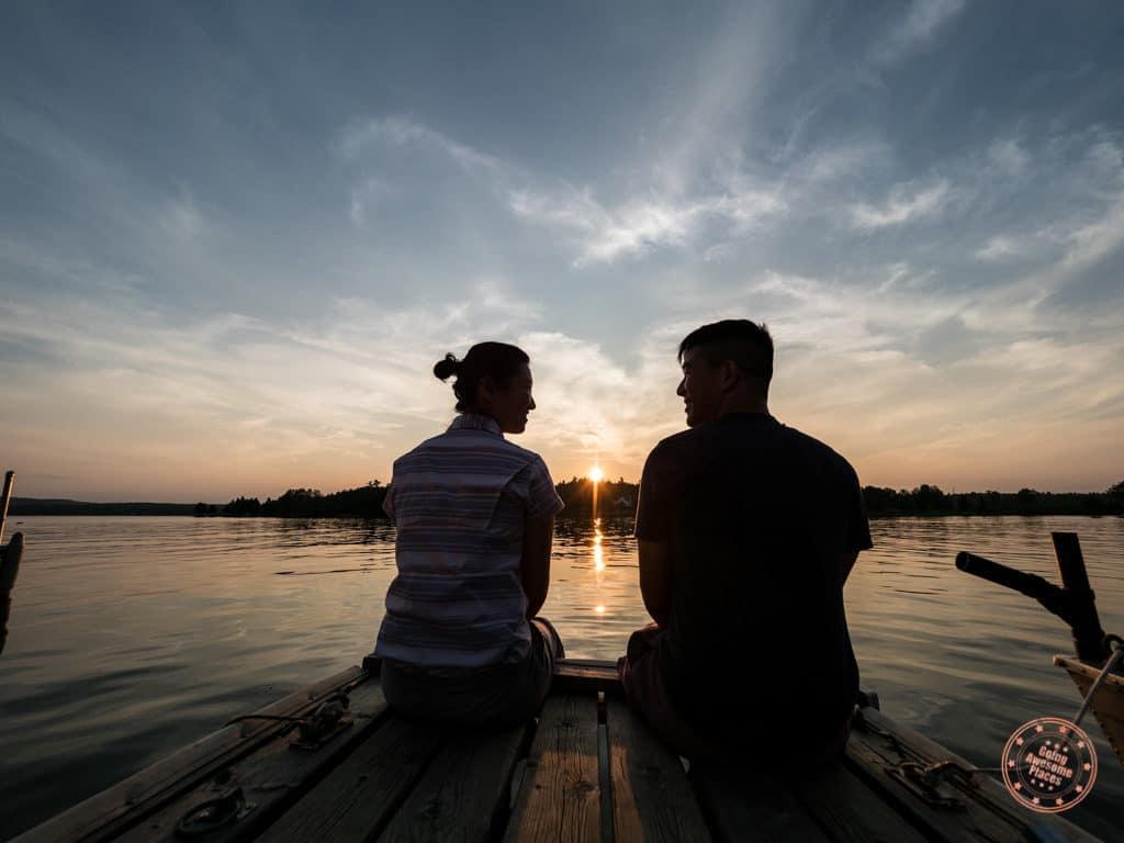 couple watch perfect sunset at calabogie lake