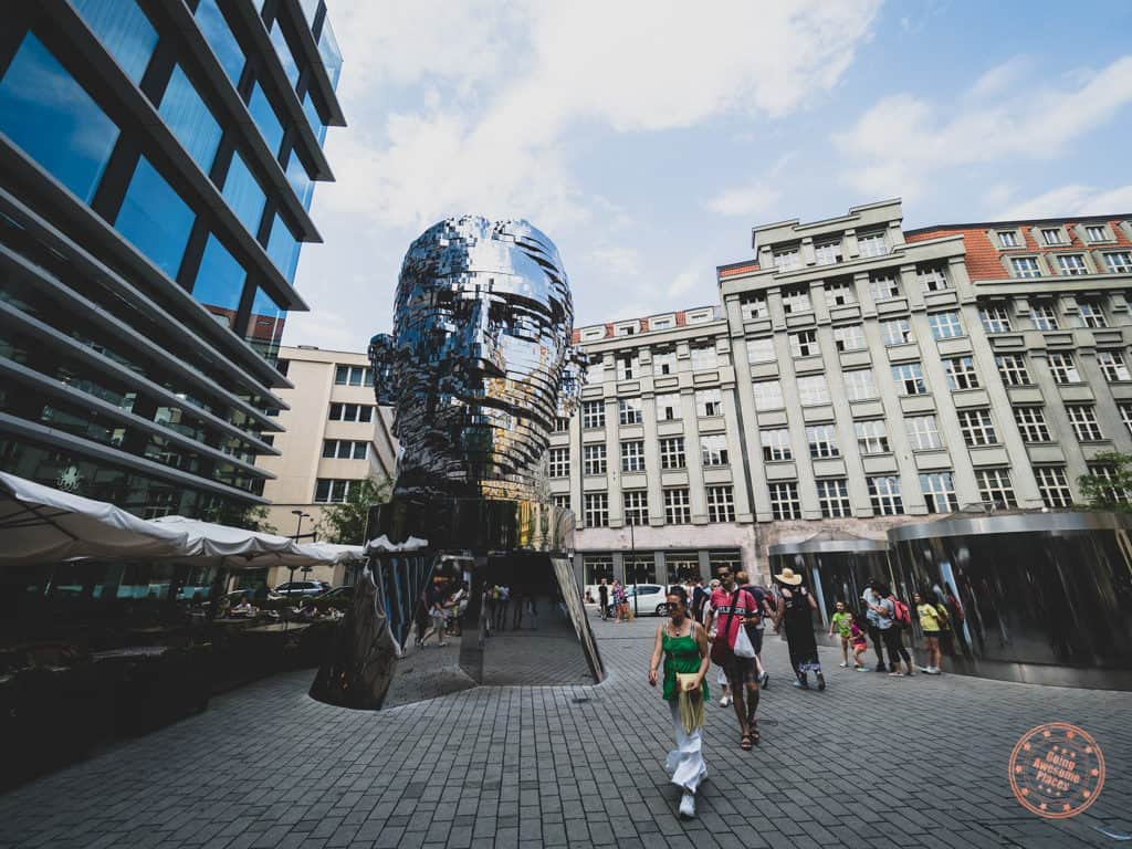 rotating sculpture of franz kafka head by david cerny in prague