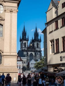 gothic church of our lady before tyn in prague old town square photo from alleyway