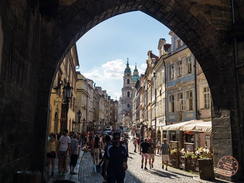 view of mala strana from underneath lesser town bridge tower
