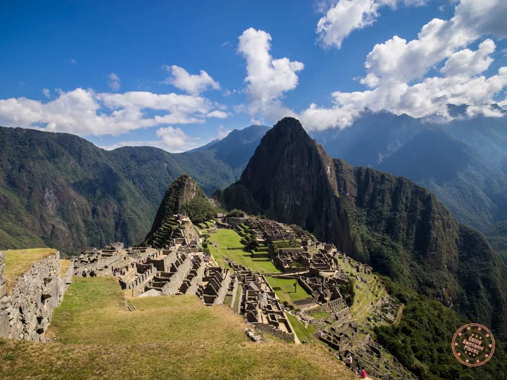 classic photo of machu picchu with huaynu picchu hike in the backdrop