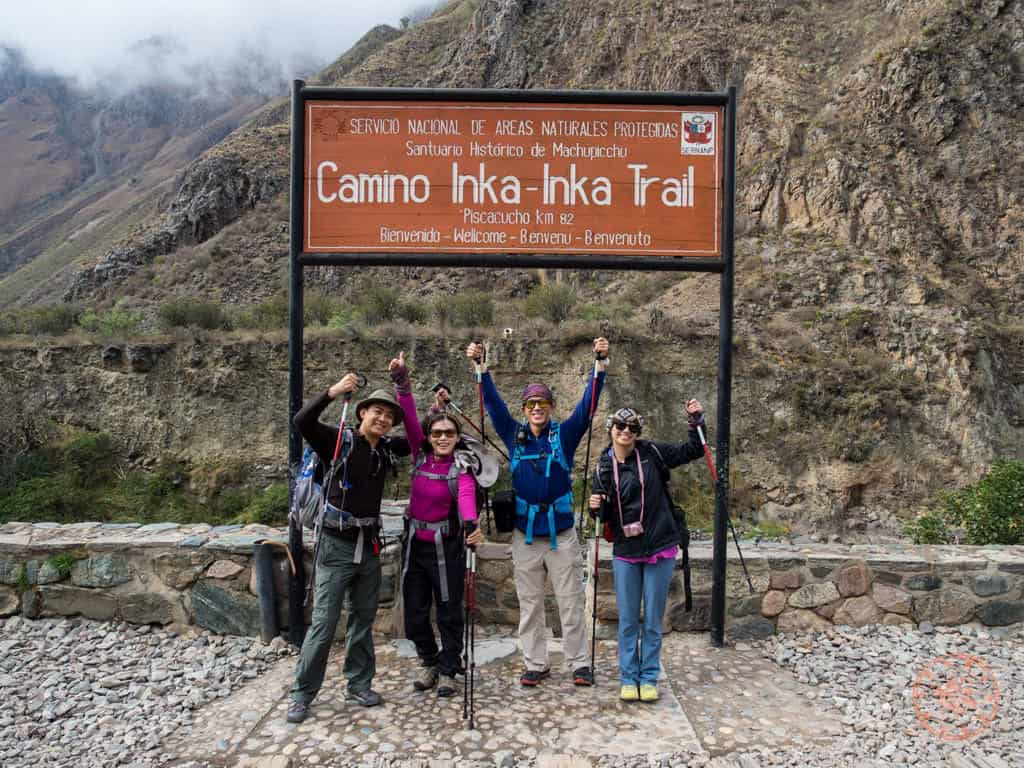 inca trail entrance group photo with friends