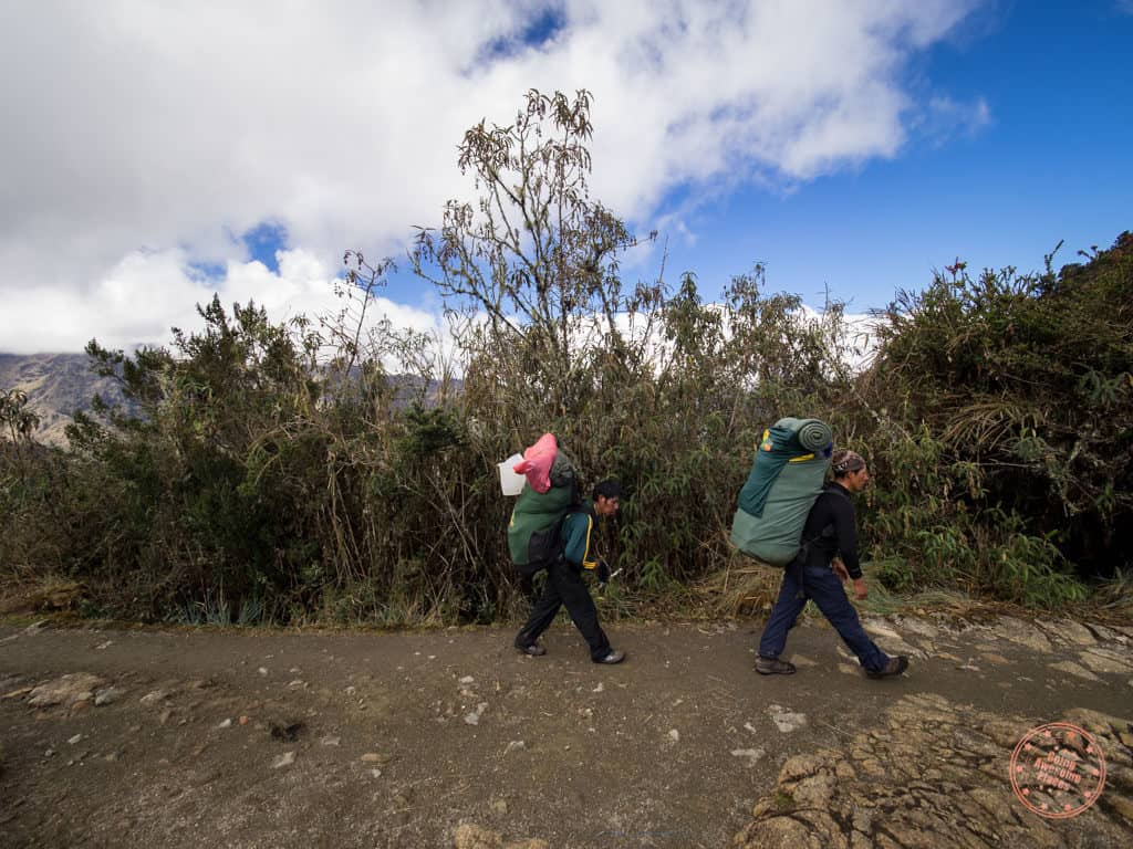 porters along the trail are the real superheroes