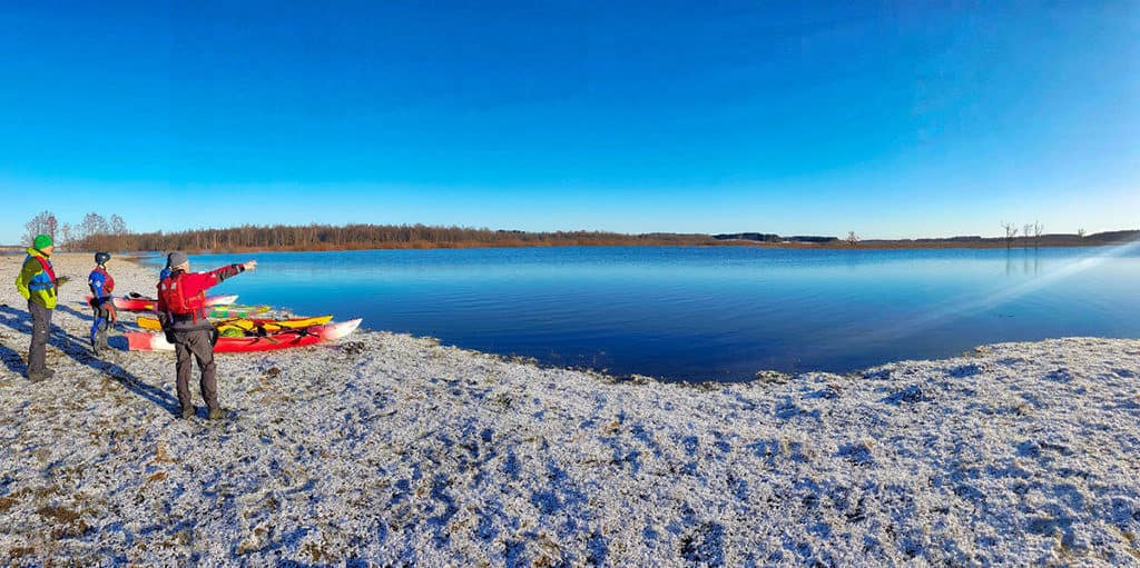 kayaking in the winter in dviete floodplain of latvia