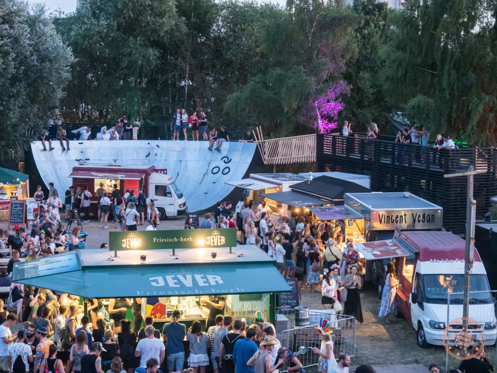 vogelball food vendors with backdrop of art installations