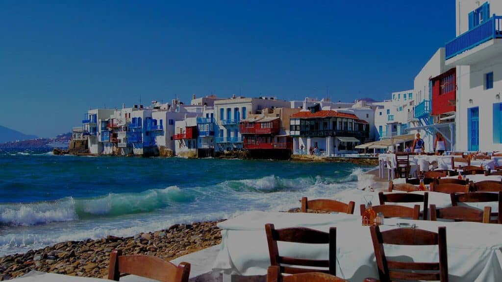 whitewashed houses in mykonos greece by the water