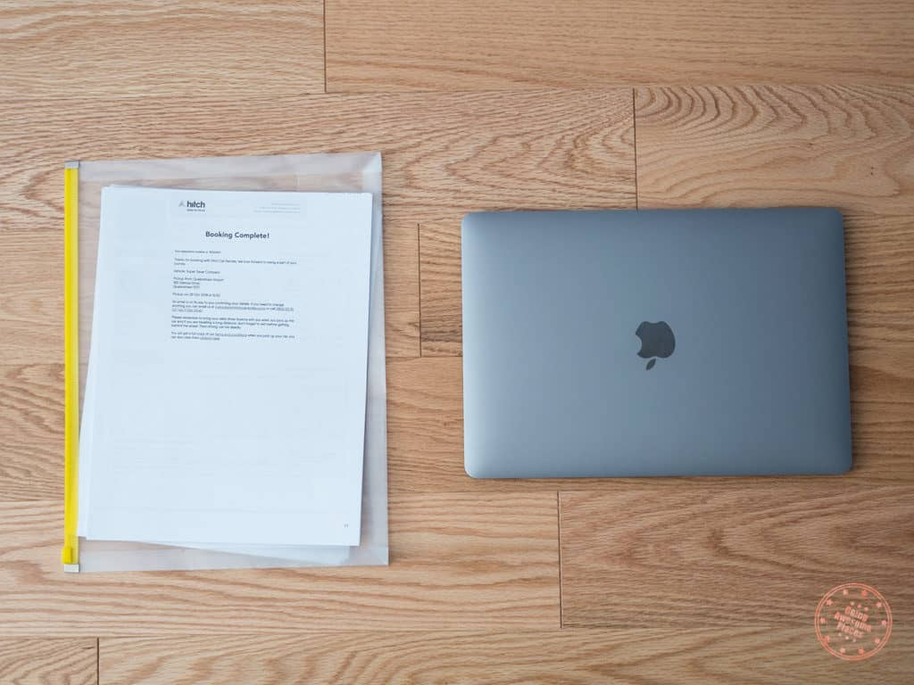 macbook pro and documents packed to new zealand