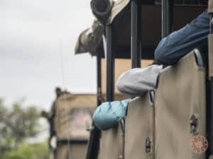 arms resting on safari truck