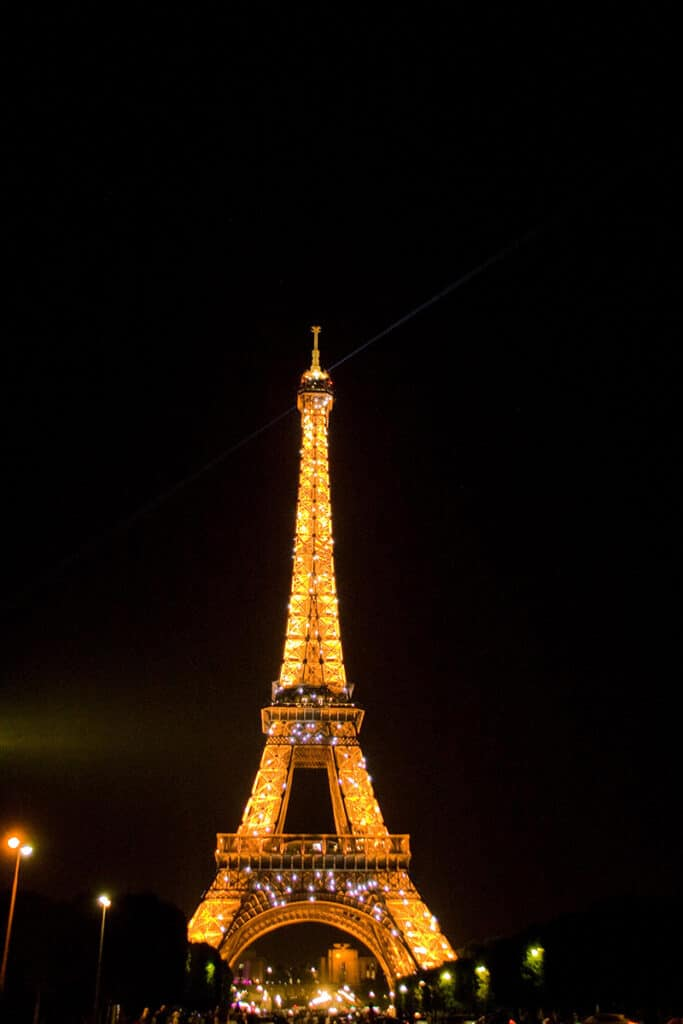 eiffel tower lit up at night