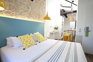 interior bedroom of le regent montmartre hostel in paris