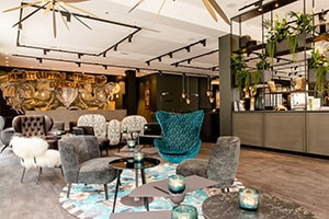 lobby with trendy lounge chairs at motel one paris porte doree