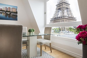residence charles floquet dining room with view of the eiffel tower
