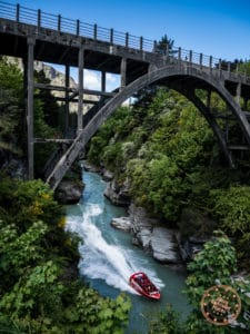 shotover jet from queenstown speeding down the river