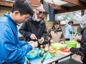 communal cooking with flying kiwi adventure bus tour
