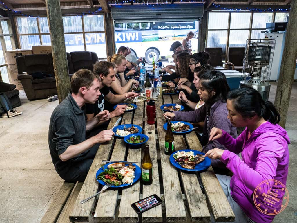 eating communal dinner with flying kiwi travel mates nz