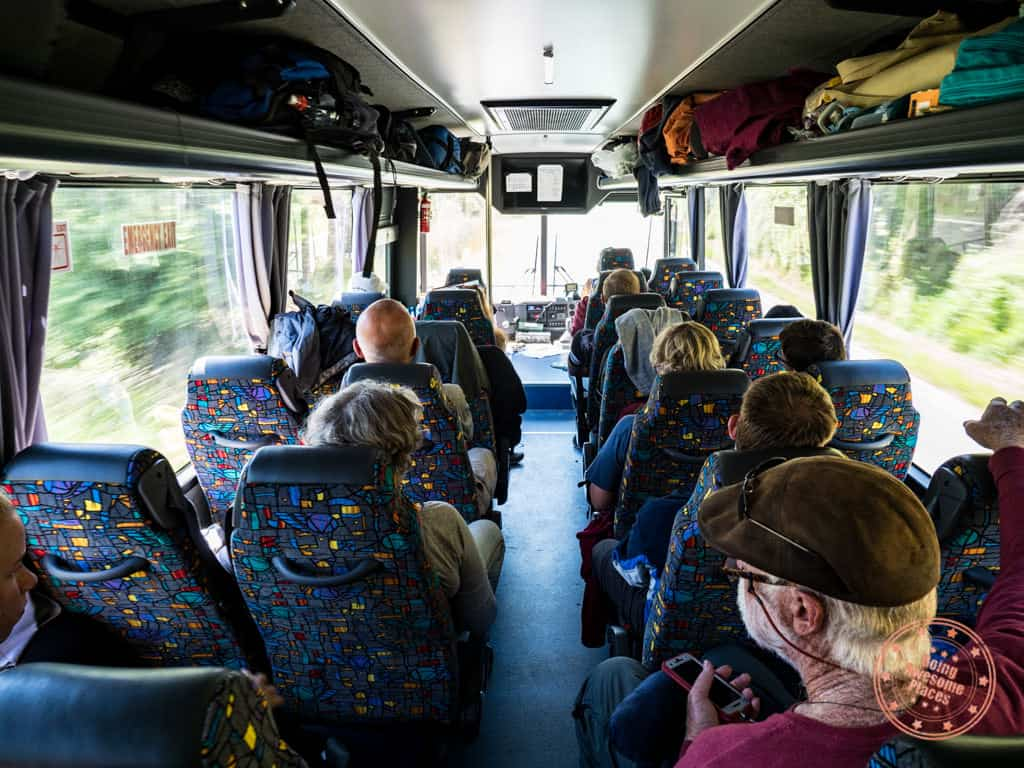 view from inside flying kiwi adventure bus tour interior