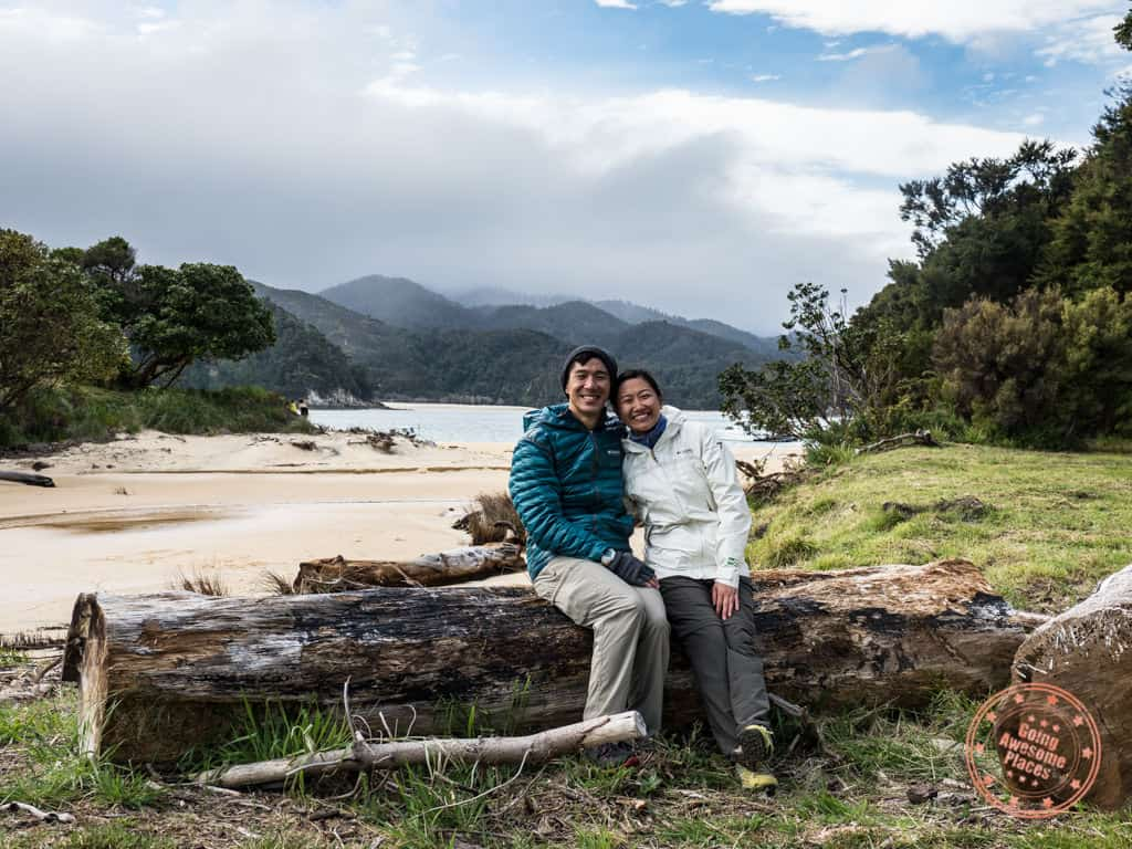 couple travellers on flying kiwi bus tour in abel tasman new zealand