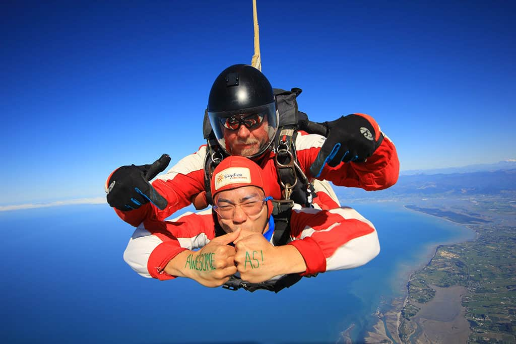 awesome as hand signs skydiving above abel tasman