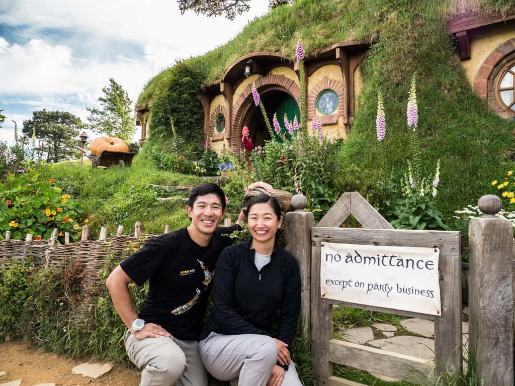 bilbo and frodo's bag end in front of no admittance sign hobbiton nz tour