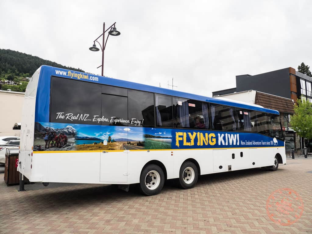 boarding flying kiwi bus in queenstown day 5 new zealand itinerary