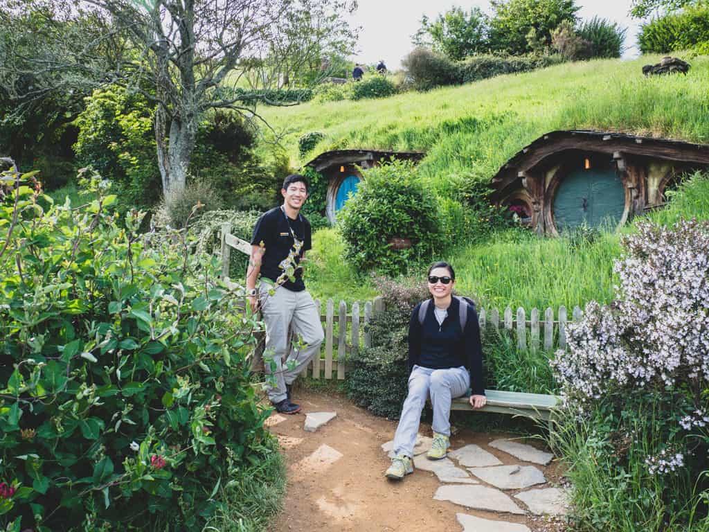 couple photo at hobbiton film set in new zealand 3 week itinerary