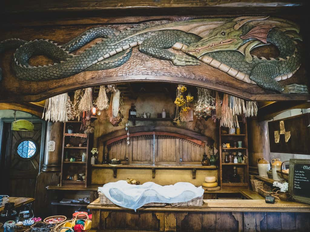 intricate motif carvings in green dragon pub hobbiton