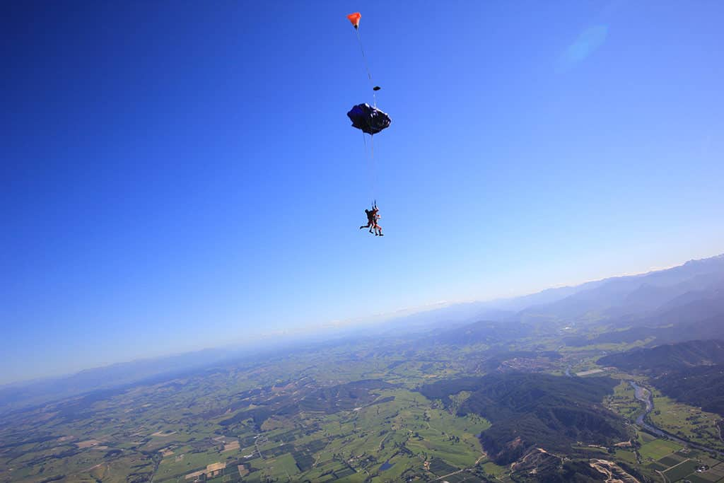 parachute deploys skydiving above abel tasman nz