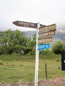 road sign for paradise road in new zealand