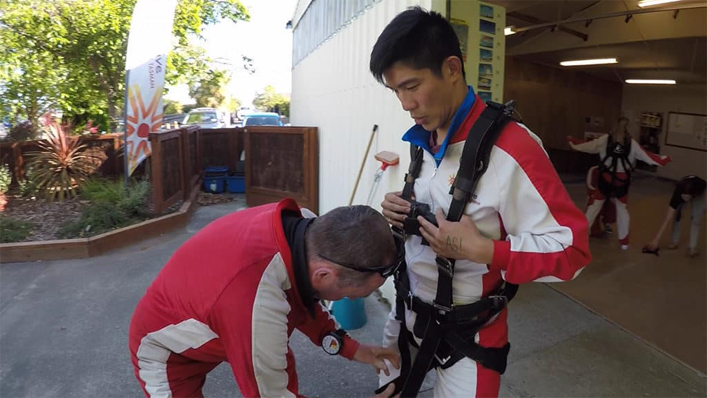 suiting up for skydiving abel tasman new zealand