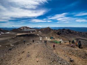 downhill rocky scramble in tongariro alpine crossing new zealand