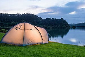 waitangi holiday park in paihia with tent by water